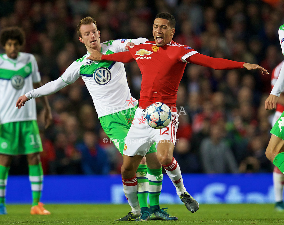 MANCHESTER, ENGLAND - Wednesday, September 30, 2015: Manchester United's Chris Smalling in action against VfL Wolfsburg's Maximilian Arnold during the UEFA Champions League Group B match at Old Trafford. (Pic by David Rawcliffe/Propaganda)