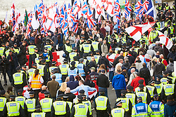 © Licensed to London News Pictures. 01/04/2017. LONDON, UK.  EDL and Britain First protest march through central London. The Met police imposed conditions on the protest and a counter protest in the expectation of serious disorder.  In this picture: EDL and Britain First marches on Victoria Embankment.    Photo credit: Cliff Hide/LNP