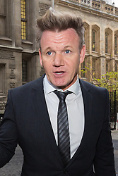 © Licensed to London News Pictures. 28/11/2014. London, UK. Gordon Ramsay arrives at the High Court in London on 28th November 2014. Mr Ramsay is involved in a legal dispute with film director, Gary Love, over a rental agreement for his York & Albany pub that Ramsay claims was signed by an electronic signature machine and without his consent. Photo credit : Vickie Flores/LNP