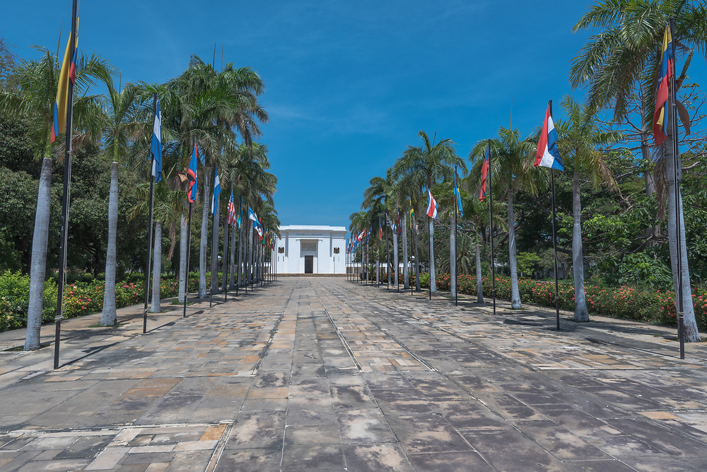 A flag lined path leads up to a museum dedicated to Simon Bolivar.