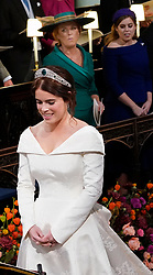 Princess Beatrice stands with her mother Sarah Ferguson as they watch Princess Eugenie marry her groom Jack Brooksbank during their wedding ceremony at St George's Chapel in Windsor Castle.