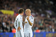 Jonjo Shelvey of Swansea City (r) chats to Gylfi Sigurdsson.<br /> Barclays Premier league match, Swansea city v Crystal Palace at the Liberty stadium in Swansea, South Wales on Saturday 29th November 2014<br /> pic by Phil Rees, Andrew Orchard sports photography.
