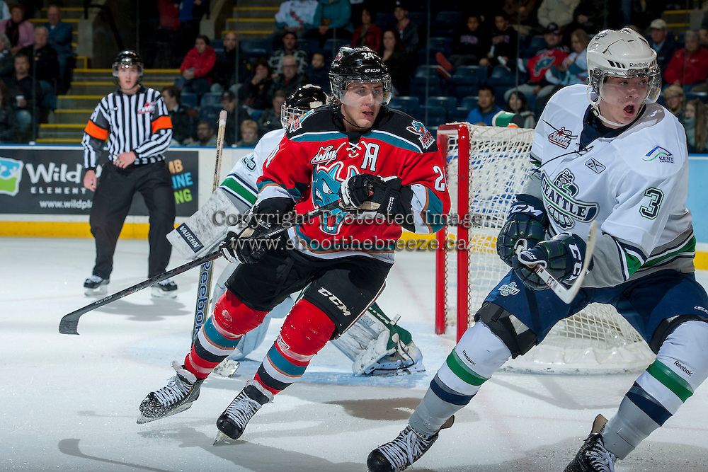 KELOWNA, CANADA - OCTOBER 11:  Tyson Baillie #24 of the Kelowna Rockets checks Kevin Wolf #3 of the Seattle Thunderbirds on October 11, 2013 at Prospera Place in Kelowna, British Columbia, Canada (Photo by Marissa Baecker/Shoot the Breeze) *** Local Caption ***