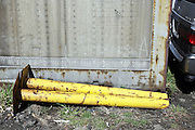 rusty yellow metal stands laying down