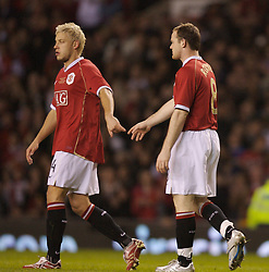 Manchester, England - Tuesday, March 13, 2007: Manchester United's Wayne Rooney celebrates scoring the opening goal against Europe XI, with his team-mate Alan Smith, during the UEFA Celebration Match at Old Trafford. (Pic by David Rawcliffe/Propaganda)