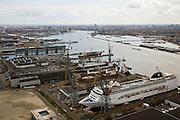Nederland, Noord-Holland, Amsterdam-Noord, 16-04-2008; scheepswerf aan de t.t. Vasumweg, met in de achtergrond hetIJ en de Houthavens; de werf is Shipdock Amsterdam (Amsterdam Ship Repair) een reparatie- en onderhouds-werf; scheepsreparatie, werf,dok,scheepsonderhoud; voorheen ADM (Amsterdamse Droogdok Maatschappij) of NDM (Nederlandse Dok Maatschappij)..luchtfoto (toeslag); aerial photo (additional fee required); .foto Siebe Swart / photo Siebe Swart