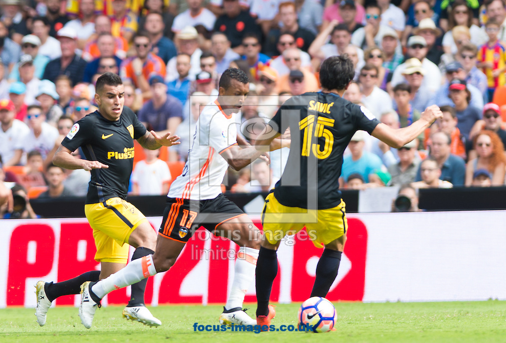 Luis Nani of Valencia CF and Stefan Savic of Atletico Madrid during the La Liga match at Mestalla, Valencia<br /> Picture by Maria Jose Segovia/Focus Images Ltd +34 660052291<br /> 02/10/2016
