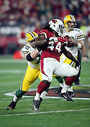 Arizona Cardinals outside linebacker Markus Golden (44) does a spin move as he tries to elude a block by Green Bay Packers tackle Bryan Bulaga (75) during the NFL NFC Divisional round playoff football game against the Green Bay Packers on Saturday, Jan. 16, 2016 in Glendale, Ariz. The Cardinals won the game in overtime 26-20. (©Paul Anthony Spinelli)