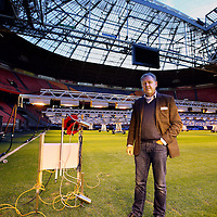 "Nederland, Amsterdam , 24 november 2014.<br /> Als eerste stadion ter wereld zet de Arena een z.g. robot (links in beeld) aan het werk om de gesteldheid van het gras te monitoren.<br /> Op de foto Henk van Raan in het stadion naast de ""grasrobot""<br /> Henk van Raan Henk is Board Member of the Amsterdam ArenA and specializes in facility and project management, preparation of project plans, maintenance concepts and planning.