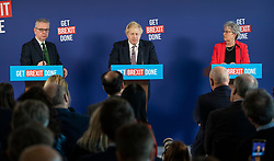 © Licensed to London News Pictures. 29/11/2019. London, UK. Prime Minister Boris Johnson answers questions at a press conference in London with Michael Gove  (L) and former Labour MP Gisela Stuart. Later a seven way TV election debate will take place with senior politicians in Cardiff. Photo credit: Peter Macdiarmid/LNP