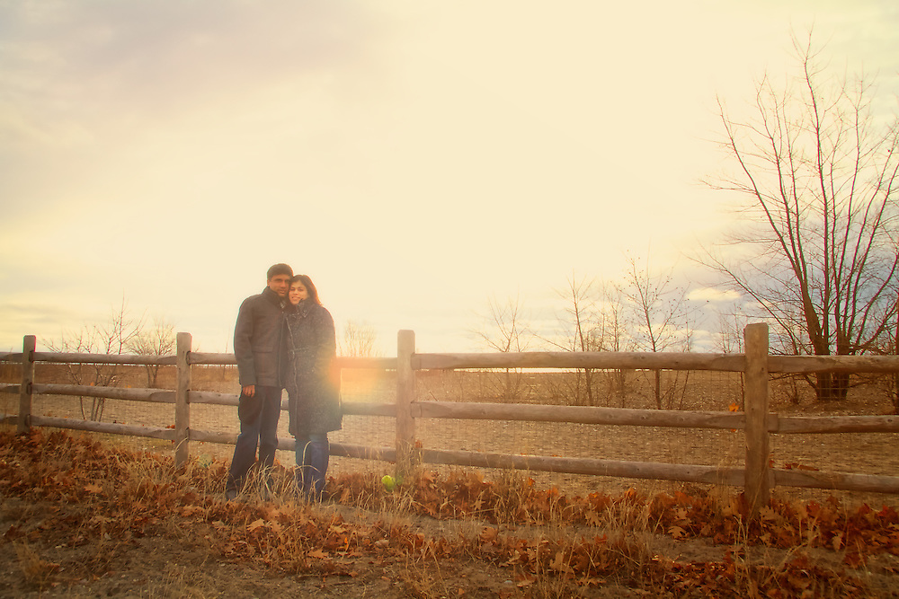 Outdoor early morning portrait of happy couple in autumn, Toronto, Canada.