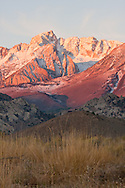The glow of sunrise hits the high peaks of the eastern Sierra, Bishop, CA