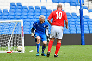 Paul Walton of England over 50's scores a goal to give a 2-0 lead to the home team during the world's first Walking Football International match between England and Italy at the American Express Community Stadium, Brighton and Hove, England on 13 May 2018. Picture by Graham Hunt.