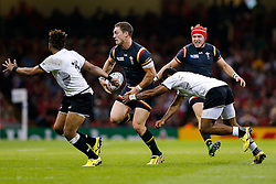 Wales Winger George North is tackled by Fiji Winger Aseli Tikoirotuma - Mandatory byline: Rogan Thomson/JMP - 07966 386802 - 01/10/2015 - RUGBY UNION - Millennium Stadium - Cardiff, Wales - Wales v Fiji - Rugby World Cup 2015 Pool A.