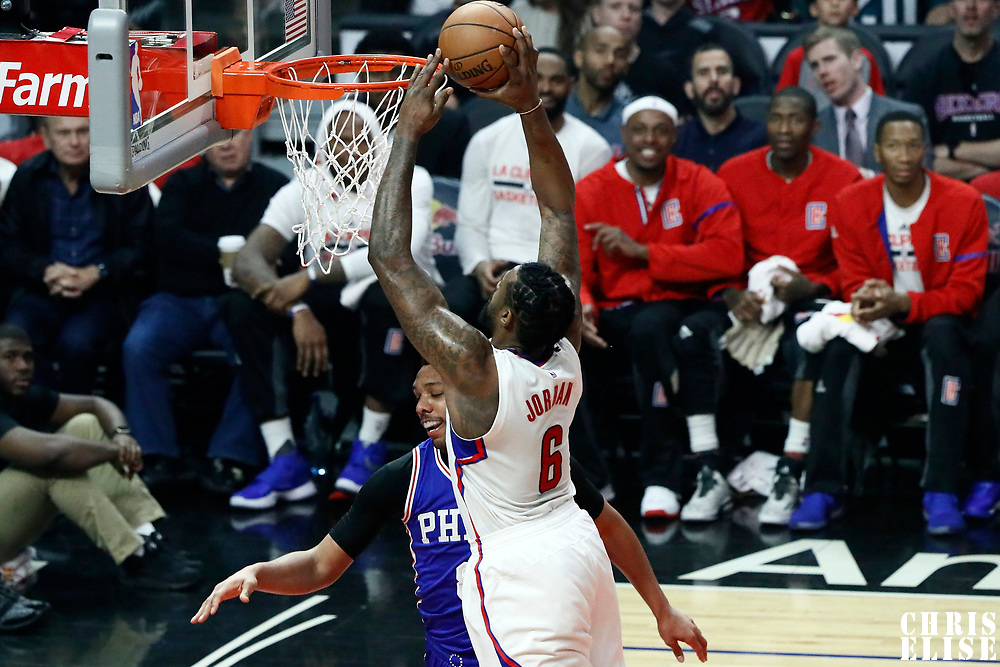 11 March 2017: LA Clippers center DeAndre Jordan (6) dunks the ball on Philadelphia 76ers center Jahlil Okafor (8) during the LA Clippers 112-100 victory over the Philadelphia Sixers, at the Staples Center, Los Angeles, California, USA.