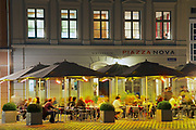 DRESDEN, GERMANY - MAY 23, 2010: Unidentified people have late meal outside of a restaurant at the central square in Dresden, Germany. Long exposure.