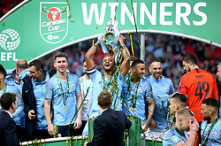Manchester City Captain Vincent Kompany (centre) and his team mates lift the trophy after winning the Carabao Cup Final at Wembley Stadium, London.