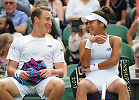 Tennis - 2017 Wimbledon Championships - Week Two, Thursday [Day Ten]<br /> <br /> Mixed Doubles, Semi Final match<br /> <br /> Rohar Bopanna (IND) and Gabriela Dabrowski (CAN) vs. Henri Kontinen (FIN) and Heather Watson (GBR)<br /> <br /> Heather Watson shares a joke with partner Henri Kontinen  on  Centre Court <br /> <br /> COLORSPORT/ANDREW COWIE