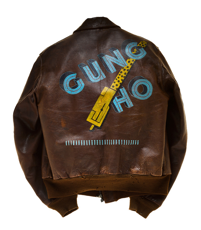 "William T. Dinwiddie, a pilot on ""Gung Ho"", wore this type A2 flight jacket. Dinwiddie and his crew were attached to the 569th squadron of the 390th Bomb Group. The 569th squadron insignia patch, a bear dropping a bomb from the clouds, is attached to the front of the jacket. Above the squadron patch is the name plate which reads ""W.T. Dinwiddie"". The name ""Gung Ho"" is painted on the back of the jacket with a yellow machine gun between the two words. Each bomb painted on the jacket represents a successful mission flown by Dinwiddie and his crew. ""Gung Ho"" completed 101 missions before being shot down on its 102nd mission. This was the third most missions by an aircraft in the 390th bombardment group."