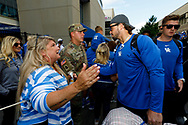 Kentucky Wildcats linebacker Kash Daniel (56) greets fans as he and the rest of the team enter Kroger Field during the Catwalk in Lexington, Ky., Saturday, Sept. 7, 2019.