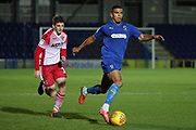 AFC Wimbledon defender Tennai Watson (2) dribbling during the EFL Trophy group stage match between AFC Wimbledon and Stevenage at the Cherry Red Records Stadium, Kingston, England on 6 November 2018.