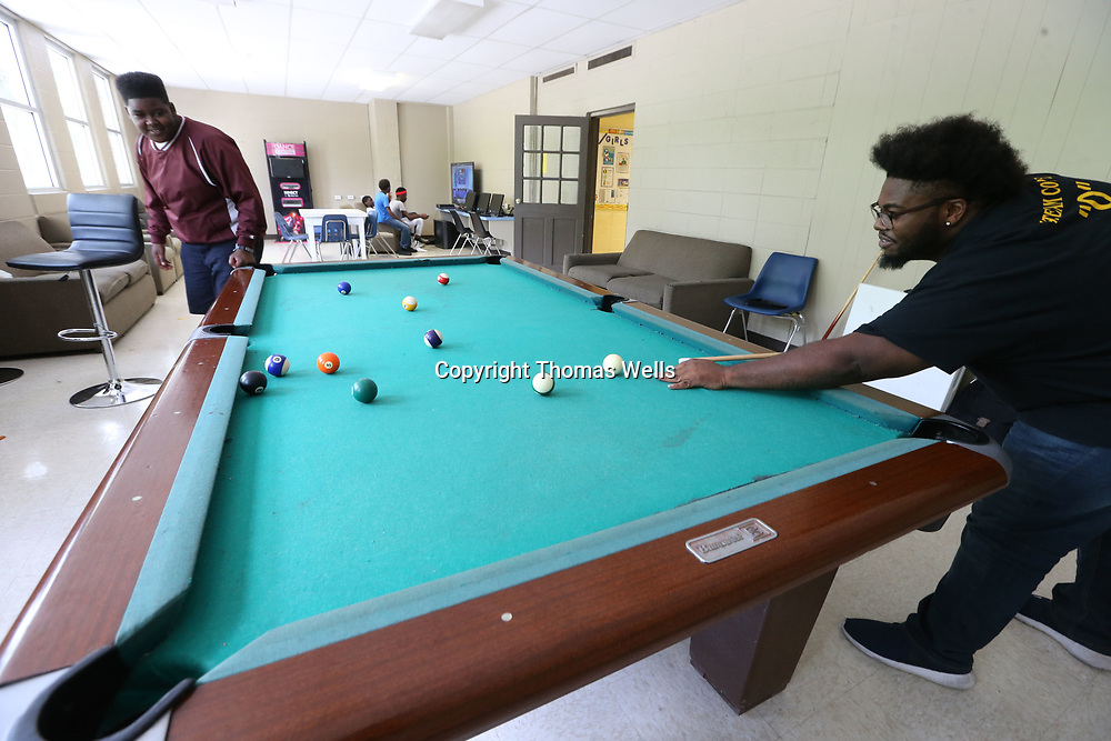 Ashton Story, left, and Tory Parker play a quick game of pool at the Northside Boys & Girls Club on Wednesday.