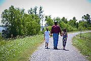Chris Leopold, candidate for the Louisiana state legislature with his daughters on the Mississippi River levee in Plaquemines Parish
