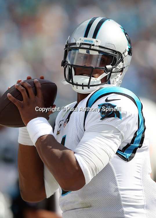 Carolina Panthers quarterback Cam Newton (1) throws a pass while warming up before the 2015 NFL week 2 regular season football game against the Houston Texans on Sunday, Sept. 20, 2015 in Charlotte, N.C. The Panthers won the game 24-17. (©Paul Anthony Spinelli)