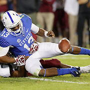 September 29, 2012 - Lexington, Kentucky, USA - UK quarterback Jalen Whitlow loses the ball as he is hit by a South Carolina defender as the University of Kentucky plays South Carolina at Commonwealth Stadium. South Carolina won the game 38-17. (Credit Image: © David Stephenson/ZUMA Press).