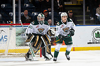 KELOWNA, BC - SEPTEMBER 28:  Keegan Karki #60 defends the net as Dylan Anderson #21 of the Everett Silvertips looks for the shot by the Kelowna Rockets  at Prospera Place on September 28, 2019 in Kelowna, Canada. (Photo by Marissa Baecker/Shoot the Breeze)