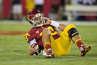 01 September 2012: Quarterback (13) Max Wittek of the USC Trojans lays on his back after a sack against the Hawaii Warriors during the second half of USC's  49-10 victory over Hawaii at the Los Angeles Memorial Coliseum in Los Angeles, CA.