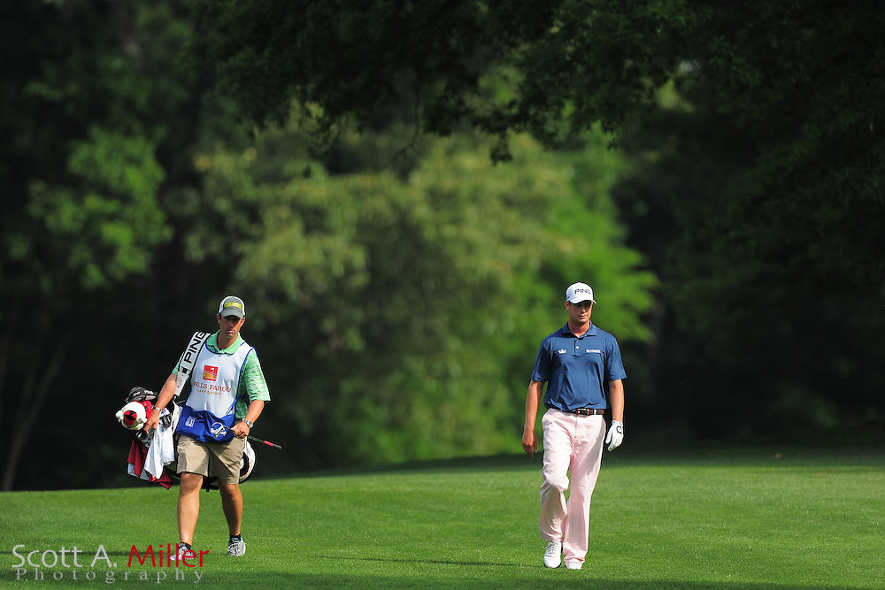 Harris English and his caddie during the third round of the Wells Fargo Championship at the Quail Hollow Club on May 5, 2012 in Charlotte, N.C. ..©2012 Scott A. Miller.