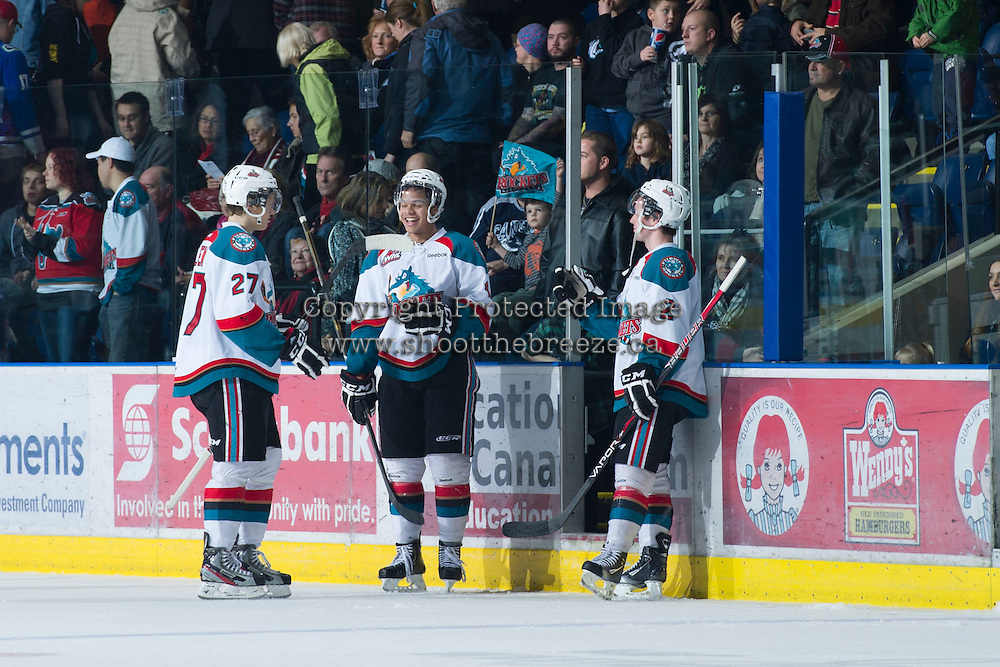 KELOWNA, CANADA - DECEMBER 30:  Tyrell Goulbourne #12, Ryan Olsen #27 and Jesse Lees #2 of the Kelowna Rockets celebrate the win Everett Silvertips at the Kelowna Rockets on December 30, 2012 at Prospera Place in Kelowna, British Columbia, Canada (Photo by Marissa Baecker/Shoot the Breeze) *** Local Caption ***