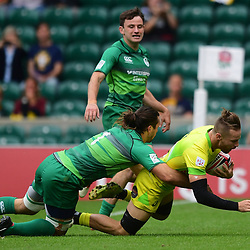 Tom Connor of Australia scores a try