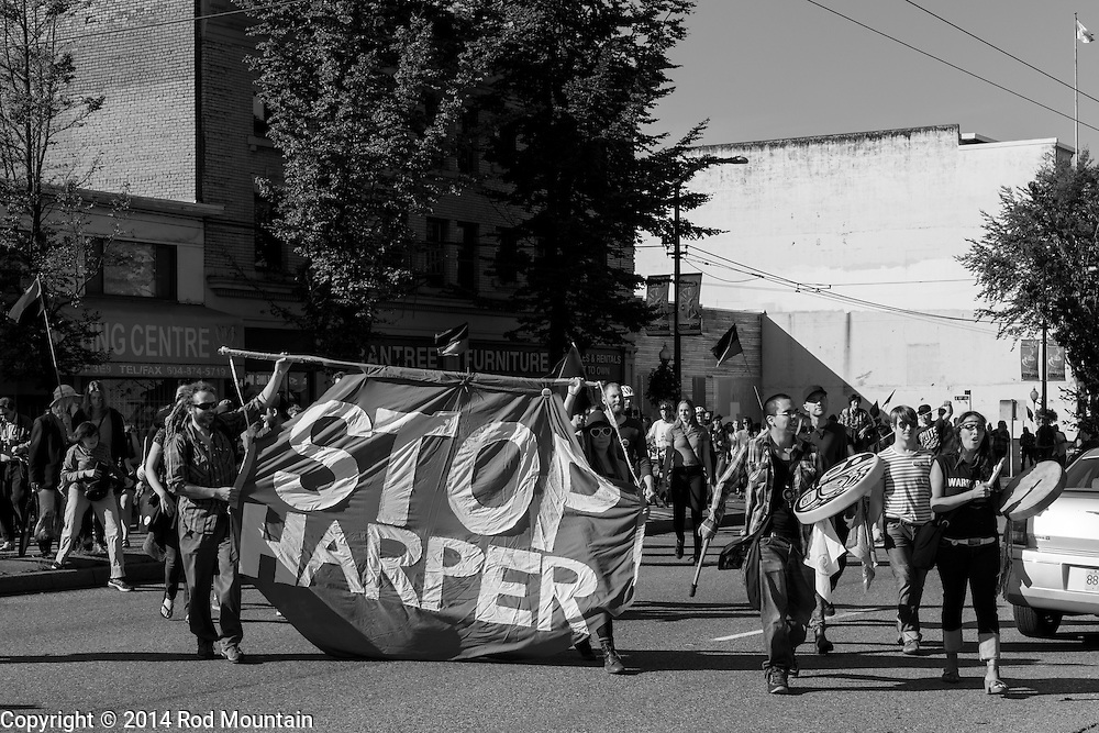 Vancouver, BC, Canada - September 27, 2014 - A 'Stop Harper' banner is displayed as part of the &quot;Party Against the Pipelines&quot; Protest in Vancouver, B.C. <br />