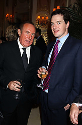 Left to right, ANDREW NEIL and GEORGE OSBORNE MP at The Business Winter Party hosted by Andrew Neil at The Ritz Hotel, Piccadilly, London on 7th December 2005.<br />