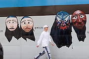 Wall paintings advertising Seoul Nori Madang open-air folcloric theatre.