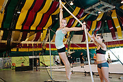 Florida State University's Flying High Circus is an extra-curricular activity for students. Every summer the circus moves to Pine Mountain, Georgia to Callaway Gardens, where the FSU students perform for crowds under a Big Top six times a week. ..Gillian DiAdezzio practices on the Spanish web while Taylor Bradow stands by before a performance on July 28, 2012.