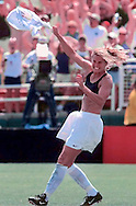 Brandi Chastain celebrates her overtime shootout goal to defeat China after a double-overtime shootout (PK 5-4) during the FIFA World Cup Finals in Pasadena, California before a record breaking crowd for a women's sporting event. (PHOTO BY ALAN LESSIG)