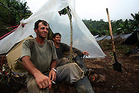 Workers hired by the Colombian government to manually eradicate coca crops rest in their camp after a long day of work, in El Campanario, in a remote area of the southern Colombian state of Nariño, on Thursday, June 21, 2007. (Photo/Scott Dalton)