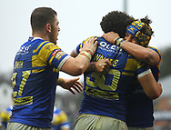 Josh Walters of Leeds Rhinos celebrates scoring the try  with team mates Cameron Smith (L) and Ashton Golding (R) against Salford Red Devils during the Betfred Super League match at Emerald Headingley Stadium, Leeds<br /> Picture by Stephen Gaunt/Focus Images Ltd +447904 833202<br /> 02/04/2018