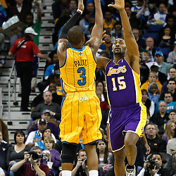 February 5, 2011; New Orleans, LA, USA; New Orleans Hornets point guard Chris Paul (3) \shoots over Los Angeles Lakers small forward Ron Artest (15) during the third quarter at the New Orleans Arena. The Lakers defeated the Hornets 101-95.  Mandatory Credit: Derick E. Hingle