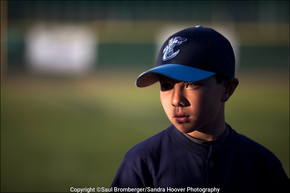 When our older son Bryce started playing T-Ball, we started to photograph him and all the teams he played on up thru the Majors Division when he was 12. Very soon during his first year it became a project not only about him for us, but about what it's like for young boys to play in Little League -- what it may feel like, their intense competition, the friendships they make, and the heartaches they go thru. <br />