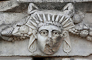 Mask and garland frieze from the Portico of Tiberius on the Southern portico of the Agora, 1st century AD, Aphrodisias, Aydin, Turkey. The Sculpture School at Aphrodisias was an important producer of carved marble sarcophagi and friezes from the 1st century BC until the 6th century AD. The Portico of Tiberius was built under the reign of Tiberius and has many examples of mask and garland friezes, consisting of the heads of gods, goddesses, theatrical characters, mythological figures or masks, each with a distinct facial expression, between hanging garlands of leaves, fruit and flowers. This example possibly represents an emperor wearing a sun ray diadem. Aphrodisias was a small ancient Greek city in Caria near the modern-day town of Geyre. It was named after Aphrodite, the Greek goddess of love, who had here her unique cult image, the Aphrodite of Aphrodisias. The city suffered major earthquakes in the 4th and 7th centuries which destroyed most of the ancient structures. Picture by Manuel Cohen