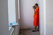 19 OCTOBER 2012 - BANGKOK, THAILAND:  A Buddhist monk takes photos with a digital camera in Wat Arun (the Temple of the Dawn) in Bangkok, Thailand. Wat Arun is one of the most historic temples in Bangkok.     PHOTO BY JACK KURTZ