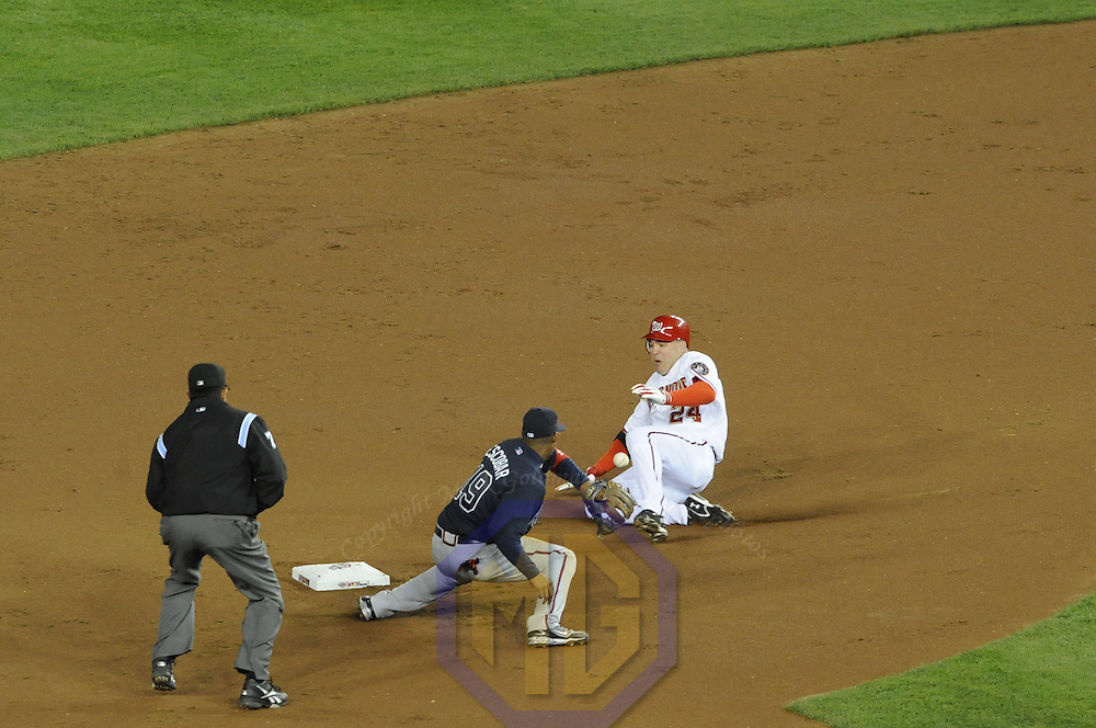 30 March 2008:  Washington Nationals first baseman Nick Johnson (24) slides safely into second base after hitting a double in the first inning to score Cristian Guzman with the first run ever at the new Nationals Park as Atlanta Braves shortstop Yunel Escobar (19) takes the late throw.  The Nationals defeated the Braves 3-2 on opening day at the new Nationals Park in Washington, D.C.   ****For Editorial Use Only****