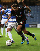 Gary Dicker trying to drive through the QPR midfield during the Capital One Cup match between Queens Park Rangers and Carlisle United at the Loftus Road Stadium, London, England on 25 August 2015. Photo by Matthew Redman.