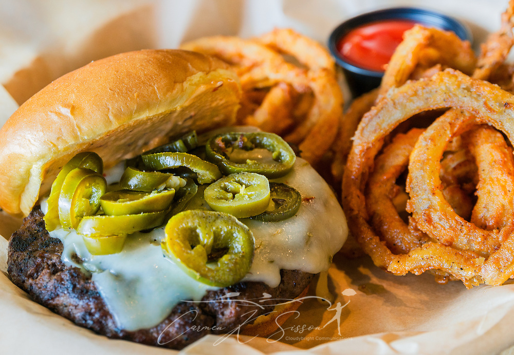 """The """"Cannonball Express"""" at The Local No. 7 in Tucker, Georgia features a char-broiled hamburger patty, jalapeños, pepperjack cheese, and 7 sauce. Diners can also build their own burger. (Photo by Carmen K. Sisson/Cloudybright)"""