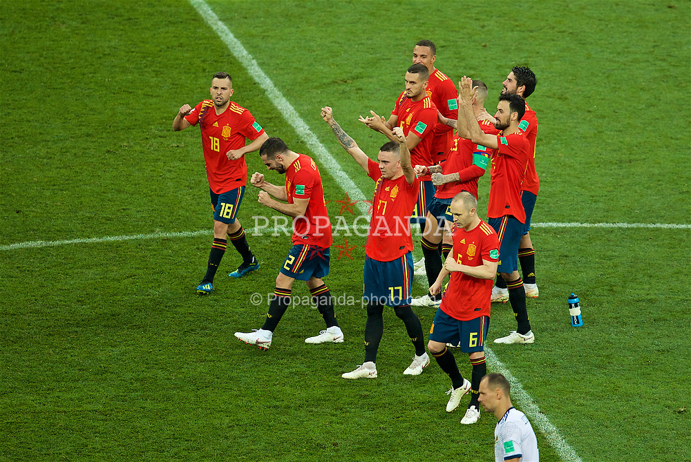 MOSCOW, RUSSIA - Sunday, July 1, 2018: Spain players celebrate after Gerard Pique scores the second penalty of the shoot-out against Russia during the FIFA World Cup Russia 2018 Round of 16 match between Spain and Russia at the Luzhniki Stadium. Russia won 4-3 on penalties after a 1-1 draw. Jordi Alba, Iago Aspas, Andres Iniesta. (Pic by David Rawcliffe/Propaganda)