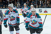 KELOWNA, CANADA - FEBRUARY 24: Kole Lind #16 and Dillon Dube #19 of the Kelowna Rockets skate to the bench to celebrate a goal against the Kamloops Blazers  on February 24, 2018 at Prospera Place in Kelowna, British Columbia, Canada.  (Photo by Marissa Baecker/Shoot the Breeze)  *** Local Caption ***